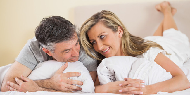 happy-mature-couple-in-bed
