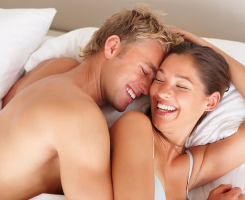 happy-young-couple-in-bed